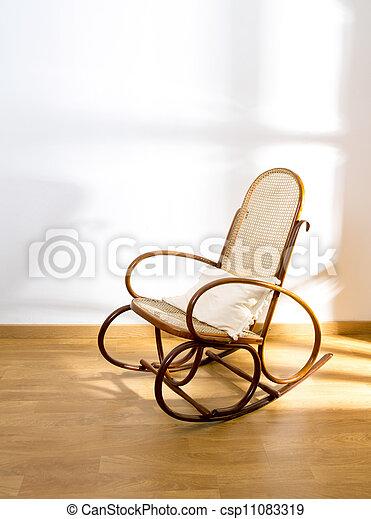 Golden Retro Rocker Wooden Swing Chair On Wood Floor   Csp11083319