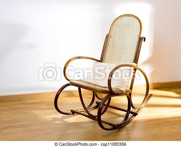 Golden Retro Rocker Wooden Swing Chair On Wood Floor   Csp11083356