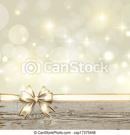 Golden ribbon bow with bokeh Christmas decoration - csp17375446