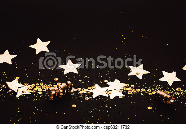 Golden stylish decoration on black background. Place for text. - csp63211732