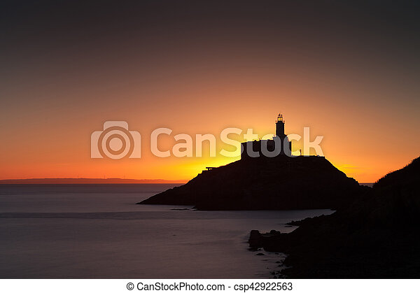 Golden sunrise over Mumbles lighthouse - csp42922563