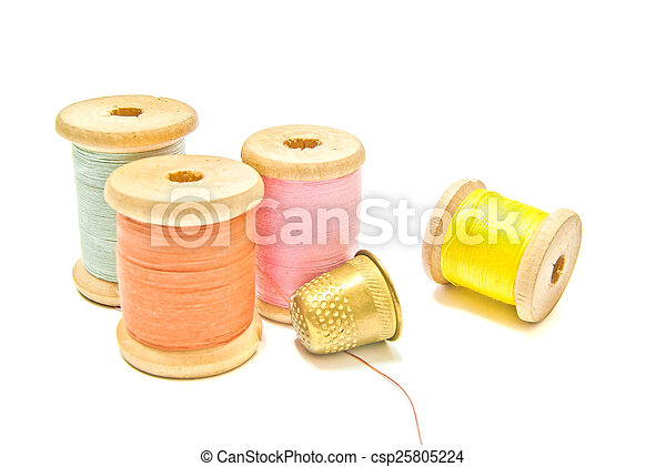 golden thimble and spools of thread - csp25805224