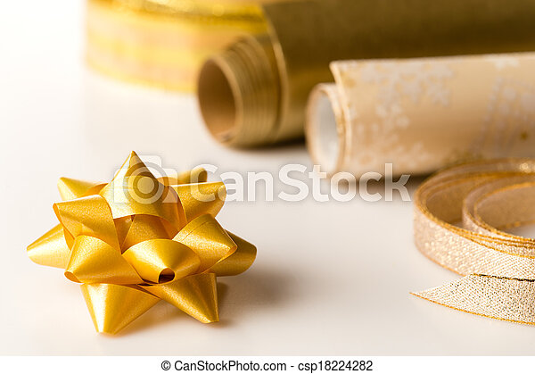 Golden wrapping paper and bow present decoration - csp18224282