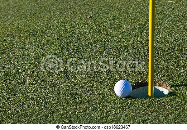 Golf ball almost in the hole - csp18623467