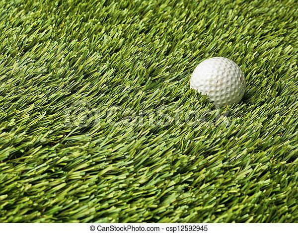 golf ball in grass - csp12592945