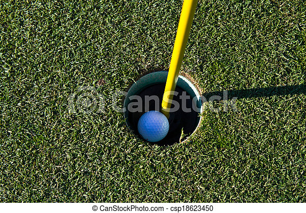 Golf ball in the cup - csp18623450