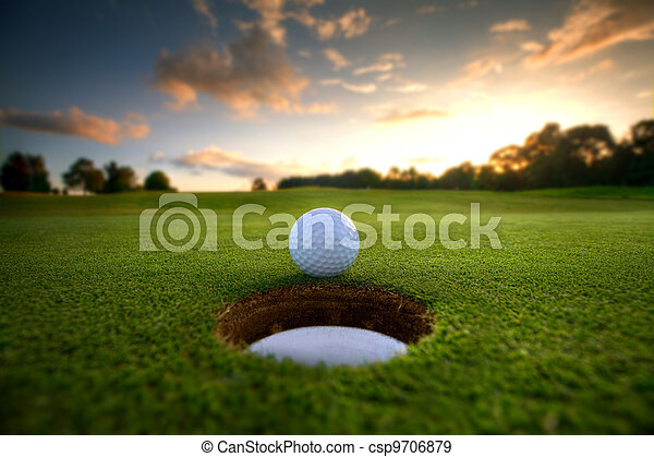 Golf Ball near hole - csp9706879