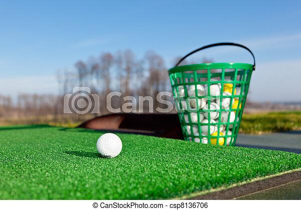 golf ball on driving range golf ball and bucket of balls on driving rh canstockphoto com Golf Ball Flight Golf Ball Flight