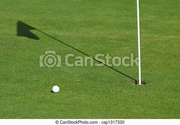 golf ball on green course - csp1317330