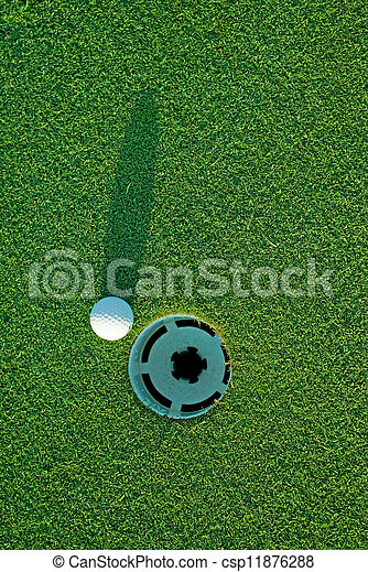 Golf ball on next to hole 4 - csp11876288