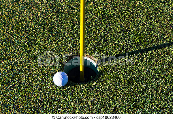 Golf ball on the edge of the cup - csp18623460