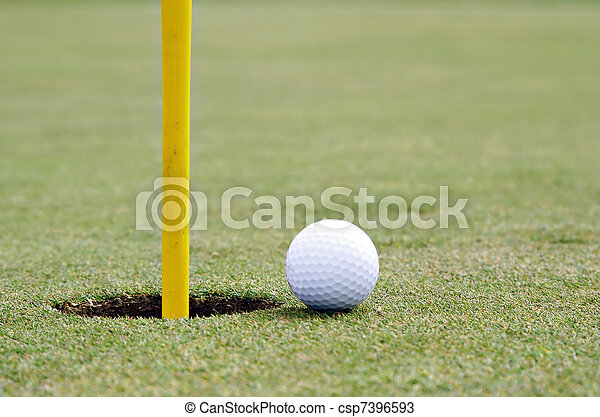 golf ball on the edge of the cup - csp7396593