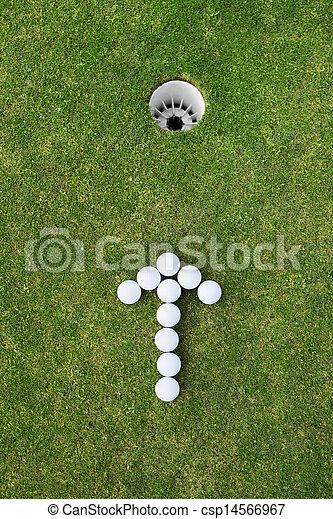 golf balls arranged as arrow sign - csp14566967