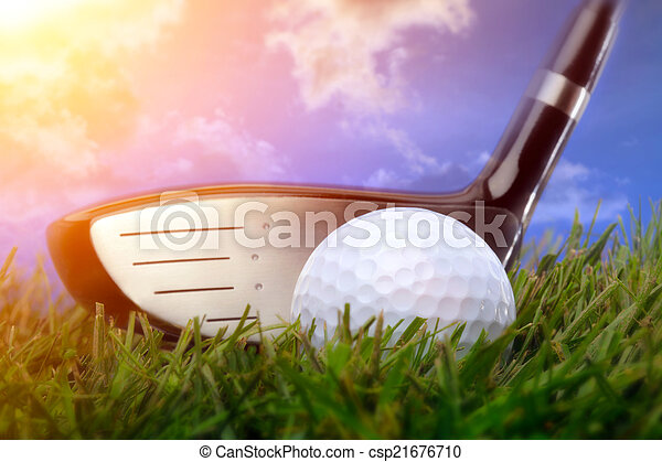Golf club and ball in grass - csp21676710