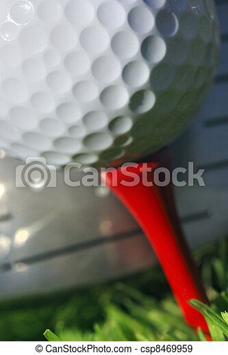 Golf club and ball in grass - csp8469959