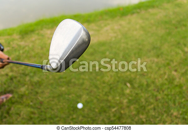 Golf club and ball in grass - csp54477808