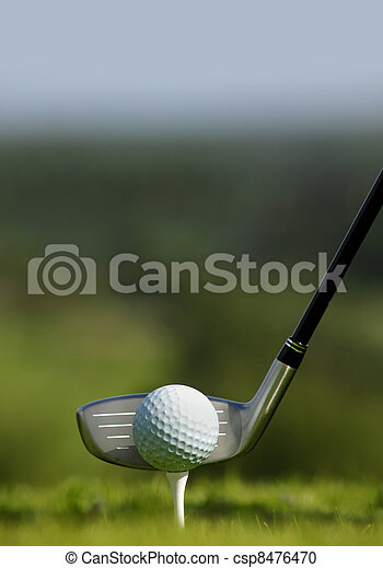 Golf club and ball in grass - csp8476470