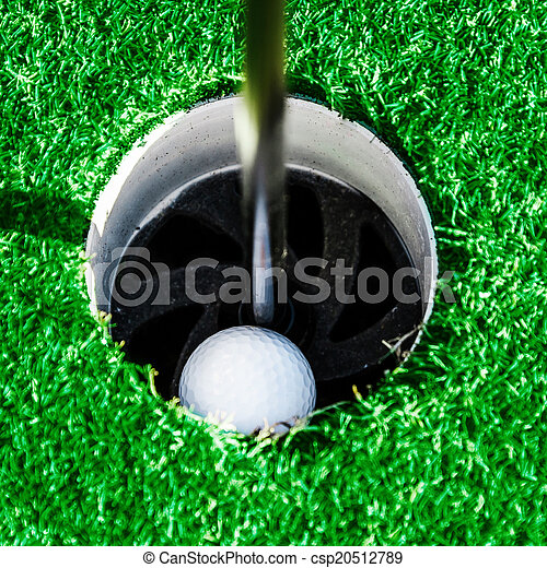 Golf club. Green field and ball in grass - csp20512789