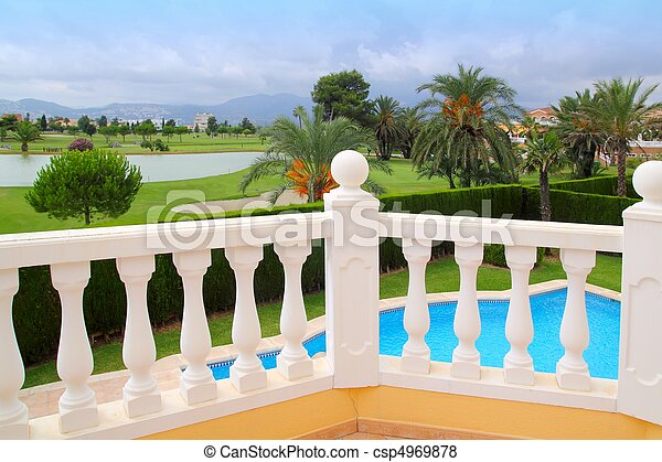 Golf course from pool housel white balustrade - csp4969878