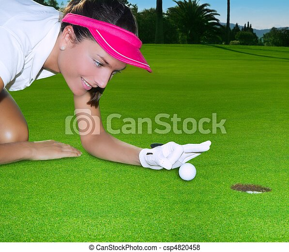 Golf green hole woman humor flicking hand a ball - csp4820458