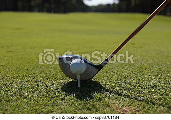golf player placing ball on tee - csp38701184