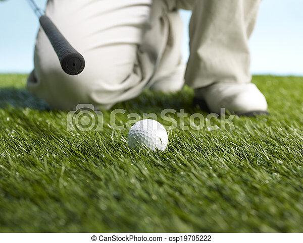 Golf Player Preparing to Hit Ball - csp19705222