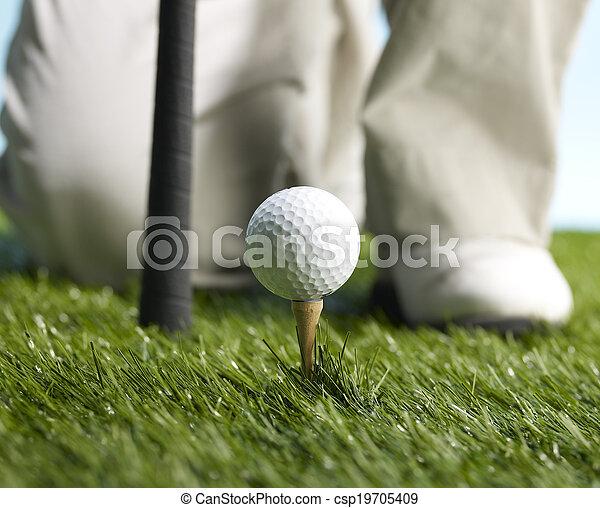 Golf Player Preparing to Hit Ball - csp19705409
