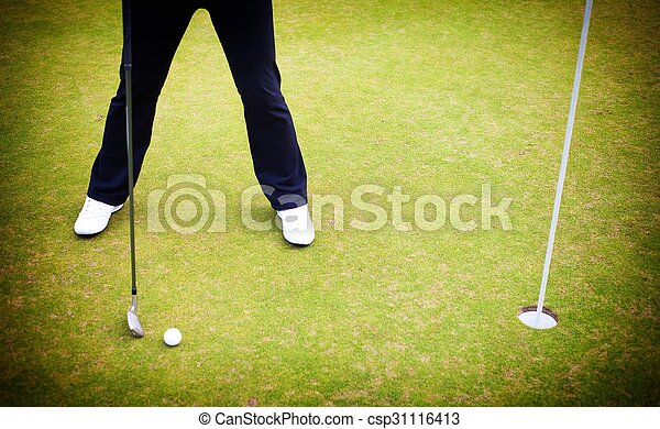 Golf player training putting ball on green - csp31116413