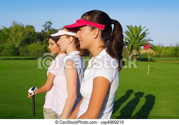 Golf three woman in a row green grass course - csp4969219