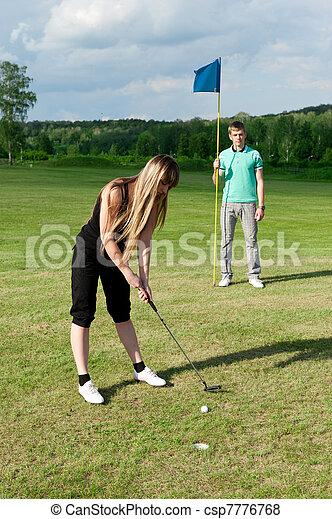 golf woman player green putting hole golf ball  - csp7776768