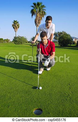 golf young man looking and aiming the hole - csp5455176