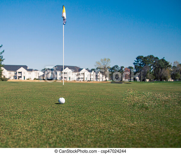 golfball and flag - csp47024244