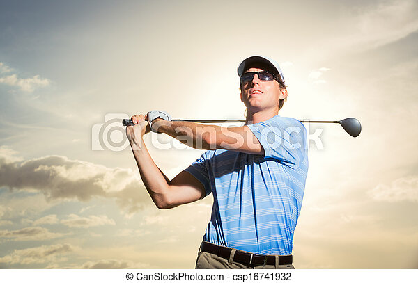 Golfer at sunset - csp16741932