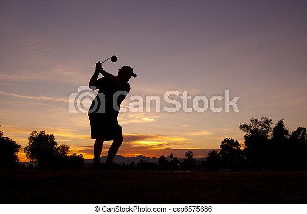 Golfer in Sunset - csp6575686
