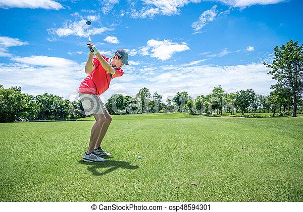 golfer playing golf with golf club on fairway - csp48594301
