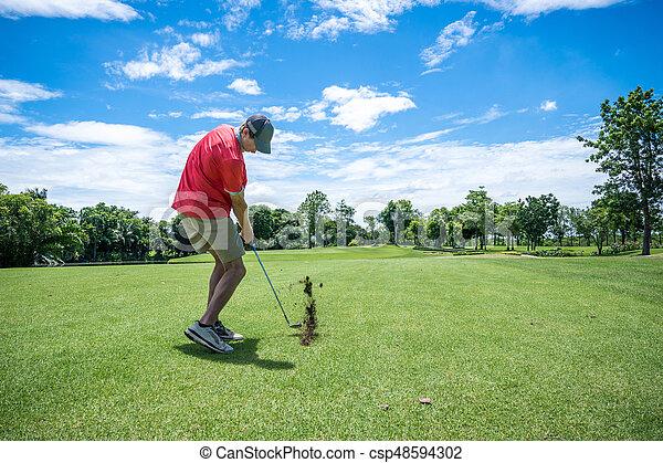 golfer playing golf with golf club on fairway - csp48594302