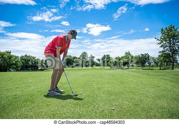 golfer playing golf with golf club on fairway - csp48594303