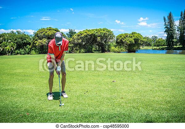 golfer playing golf with golf club on fairway - csp48595000