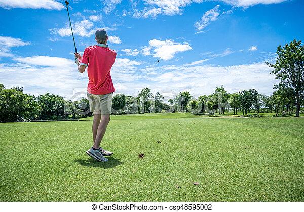 golfer playing golf with golf club on fairway - csp48595002