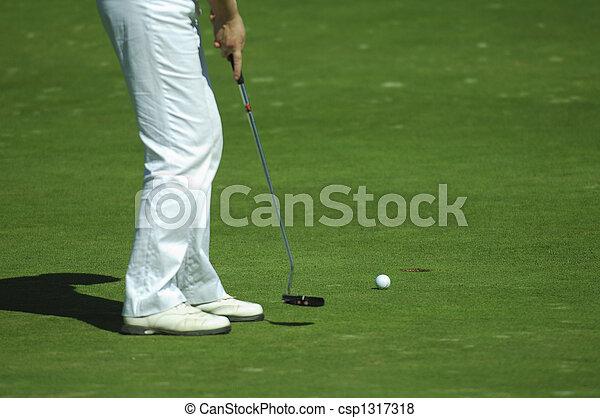 Golfer putting a golf ball - csp1317318