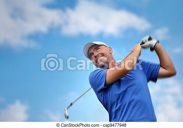 golfer shooting a golf ball - csp9477948