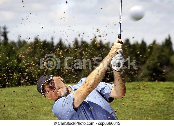 golfer shooting a golf ball - csp6666045