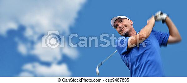 golfer shooting a golf ball - csp9487835