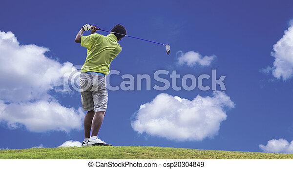 Golfer shooting a golf ball - csp20304849