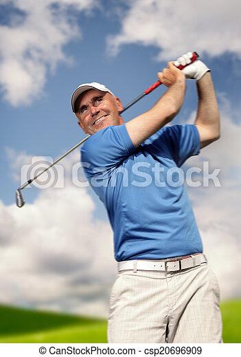 golfer shooting a golf ball - csp20696909