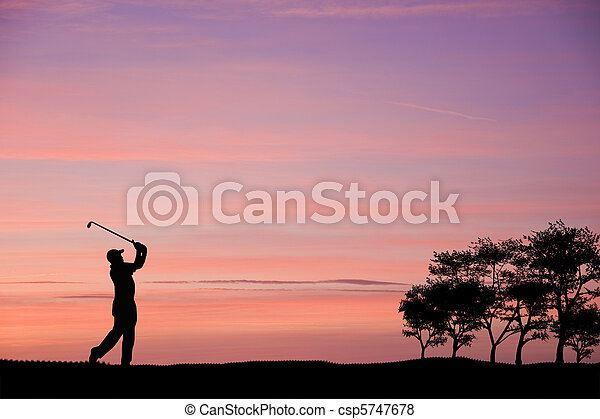 Golfer silhouette against colorful sunset sky - csp5747678