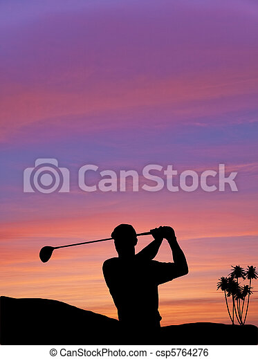 Golfer silhouette against colorful sunset sky - csp5764276