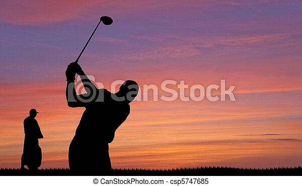 Golfer silhouette against colorful sunset sky - csp5747685