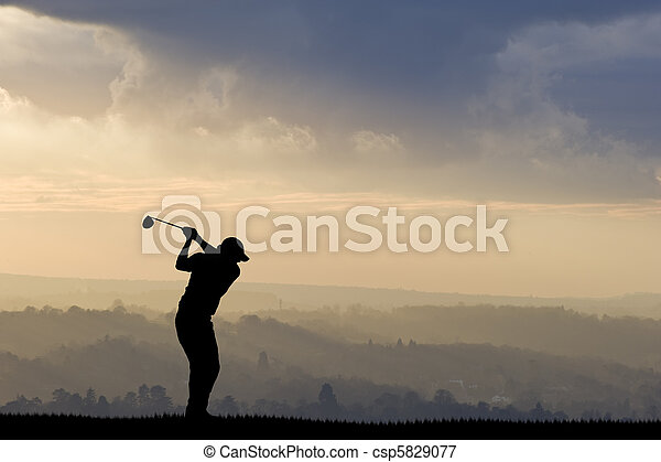 Golfer silhouette against stunning - csp5829077