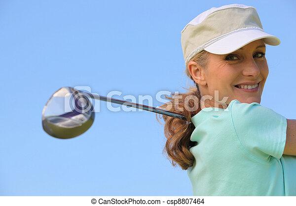 Golfer taking a swing - csp8807464